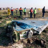 """(FILES) In this file handout photo provided by the Iranian news agency IRNA on January 8, 2020, rescue teams work at the scene of a Ukrainian airliner that crashed shortly after take-off near Imam Khomeini airport in the Iranian capital Tehran. - US officials believe that Iran accidentally shot down the Ukrainian airliner, killing all of the 176 people on board, US media reported on January 9, 2020. Newsweek, CBS and CNN quoted unnamed officials saying they are increasingly confident that Iranian air defense systems accidentally downed the aircraft, based on satellite, radar and electronic data. (Photo by Akbar TAVAKOLI / IRNA / AFP) / RESTRICTED TO EDITORIAL USE - MANDATORY CREDIT """"AFP PHOTO/IRNA/AKBAR TAVAKOLI"""" - NO MARKETING NO ADVERTISING CAMPAIGNS - DISTRIBUTED AS A SERVICE TO CLIENTS - --"""