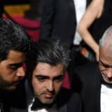 Den herboende syriske instruktør Feras Fayyad (i midten) var i Los Angeles sidste år, da han var nomineret til en Oscar for filmen »Last Men in Aleppo«. Arkivfoto: Robyn Beck/AFP/Ritzau Scanpix