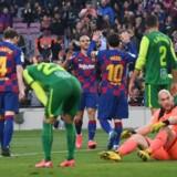 Braithwaite jubler sammen med Messi efter argentinerens scoring til 4-0.