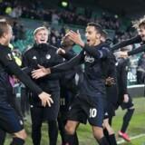 FCKs Carlos Zeca, Rasmus Falk og Pierre Bengtsson jubler efter Europa League-kampen mellem Celtic og FCK på Celtic Park.