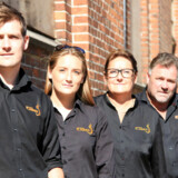 Familien bag restaurantkæden Flammen: Martin, Kristina, Ketty og Flemming Rosenfeldt Sunddal. Det er kædens administrerende direktørs forventning, at familiens livsværk vil overleve krisen.