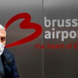 A passenger wearing a protective facemask arrives at the Brussels Airport, in Zaventem, outside Brussels, on March 9, 2020, during a COVID-19 outbreak. - All European Union States are hit by the novel coronavirus. (Photo by JOHN THYS / AFP)