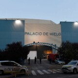 Policemen stand outside the Palacio de Hielo (Ice Palace) shopping mall where an ice rink was turned into a temporary morgue on March 23, 2020 in Madrid to deal with a surge in deaths in the Spanish capital due to the coronavirus. - The coronavirus death toll in Spain surged to 2, 182 after 462 people died within 24 hours, the health ministry said. The death rate showed a 27-percent increase on the figures released a day earlier, with the number of confirmed cases of COVID-19 rising to 33, 089 in Spain, one of the worst-hit countries in the world after China and Italy. (Photo by PIERRE-PHILIPPE MARCOU / AFP)