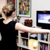 Nintendos Wii ændrede helt spillekonsollernes funktion. Nu dyrkes der sport foran skærmen. Foto: Kristoffer Juel Poulsen, Scanpix