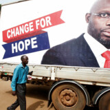 A supporter of George Weah, former soccer player and presidential candidate of Coalition for Democratic Change (CDC), listens to the announcement of the presidential election results on the radio, in Monrovia, Liberia December 27, 2017. REUTERS/Thierry Gouegnon