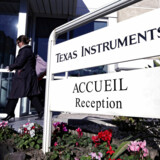 FILE PHOTO - An employee enters the research building of Texas Instruments France firm in Villeneuve-Loubet near Nice December 18, 2012. REUTERS/Eric Gaillard/File Photo GLOBAL BUSINESS WEEK AHEAD PACKAGE - SEARCH BUSINESS WEEK AHEAD 23 JANUARY FOR ALL IMAGES
