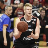 A picture taken on January 23, 2015 in Hasselt shows Charleroi's Danish player Rasmus Larsen in action during the basketball match between Limburg United and Spirou Charleroi, on the 17th day of the Scooore League Basketball competition. Larsen was found dead on May 13, 2015 at his home in Charleroi. The cause of the death of the 20-year-old Spirou Charleroi player is unknown. AFP PHOTO / BELGA / VIRGINIE LEFOUR