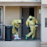 DALLAS, TX - OCTOBER 06: Members of the Cleaning Guys Haz Mat clean up company are seen as they work on sanitizing the apartment where Ebola patient Thomas Eric Duncan was staying before being admitted to a hospital on October 6, 2014 in Dallas, Texas. The first confirmed Ebola virus patient in the United States was staying with family members at The Ivy Apartment complex before being treated at Texas Health Presbyterian Hospital Dallas. State and local officials are working with federal officials to monitor other individuals that had contact with the confirmed patient. Joe Raedle/Getty Images/AFP == FOR NEWSPAPERS, INTERNET, TELCOS & TELEVISION USE ONLY ==