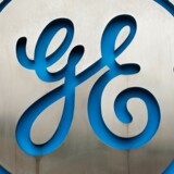(FILES) This file photo taken on June 11, 2016 shows the logo at the entrance of General Electric (GE) Celma, GE's aviation engine overhaul facility in Petropolis, Rio de Janeiro, Brazil. General Electric shares fell on October 20, 2017 after it reported lower earnings and slashed its profit forecast, raising the stakes for next month's turnaround presentation by its new CEO.GE, reporting a drop in third-quarter earnings due to continued weakness in the power and oil and gas businesses, said it would divest $20 billion in assets in the next two years. / AFP PHOTO / YASUYOSHI CHIBA