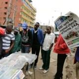 epa06135113 People gather around a newspaper stand, during the second day of protests held by supporters of opposition leader Raila Odinga from The National Super Alliance (NASA) coalition, in Mathare North one of Odinga's strongholds in Nairobi, Kenya, 10 August 2017. The protests began after Odinga announced his rejection of the provisional results in the presidential election that shows incumbent Uhuru Kenyatta leading. Odinga announced that the official tally doesn't match his own party's count. EPA/DANIEL IRUNGU