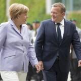 Kansler Angela Merkel byder Lars Løkke Rasmussen velkommen i Berlin.