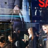 NEW YORK, NY - DECEMBER 13: Shoppers are reflected in a store's window as they walk down the busy shopping street of Broadway on December 13, 2011 in New York City. As progress continues to show in the American economy, November saw the sixth straight monthly increase in retail sales. According to government reports today, retail sales rose 0.2 percent in November. Spencer Platt/Getty Images/AFP