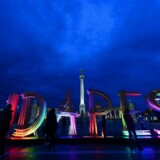 FILES - Picture taken on March 23, 2014, shows locals and tourists posing for photos in front of a giant illuminated 'Budapest' sign at the Heroes square of Budapest. The city of Budapest on July 8, 2015, launched a bid to host the Olympics in 2024, in a letter sent to the president of the International Olympics Committee. AFP PHOTO / ATTILA KISBENEDEK
