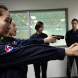 epa05689065 Flight attendants of Korean Air Lines Co. learn how to use stun guns against in-flight violence during training in Seoul, South Korea, 27 December 2016. The flag carrier has instructed its flight crew to resort to active force when needed after unruly behavior by a drunken passenger last week became a widely publicized controversy. EPA/YONHAP SOUTH KOREA OUT