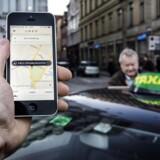 Uber app og taxa på Kongens Nytorv.