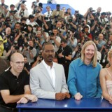 """(L TO R) The giant green ogre known as Shrek, Dreamworks executive producer Jeffrey Katzenberg, US actor Eddie Murphy, US director Andrew Adamson, US actress Cameron Diaz, and US actor Mike Meyers, pose during a photo call for the film """"Shrek 2"""", 15 May 2004 at 57th the Cannes Film Festival in the French Riveria town. The Hollywood film is in competition for the festival's top prize, the Palme d'Or. AFP PHOTO/PASCAL GUYOT"""