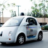 (FILES) This file photo taken on January 8, 2016 shows a Google self-driving car traversing a parking lot at Google's headquarters in Mountain View, California. Google parent Alphabet on May 3, 2016 announced that it has partnered with Fiat Chrysler to expand its fleet of self-driving vehicles. The Google autonomous test fleet would be more than doubled with the addition of 100 new 2017 Chrysler Pacifica Hybrid minivans, with the companies aiming to have some on the road by the end of this year. / AFP PHOTO / Noah Berger