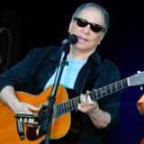 "US singer Paul Simon performs on stage in Berlin on July 11, 2011. Simon, known from the band ""Simon and Garfunkel"", presents his latest album ""So Beautiful or So What"". AFP PHOTO / BRITTA PEDERSEN GERMANY OUT"