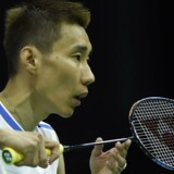Malaysia's Lee Chong Wei returns against France's Brice Leverdez during their round one men's singles match during the 2017 BWF World Championships of badminton at Emirates Arena in Glasgow on August 22, 2017. / AFP PHOTO / ANDY BUCHANAN