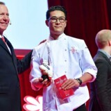 Chef Kristian Baumann (R) from restaurant 108 in Copenhagen Denmark is awarded with one Michelin star by Michelin Guides' international director Michael Ellis during a presentation of the new Michelin Guide Nordic Countries in Stockholm on February 22, 2017. / AFP PHOTO / TT News Agency / Jessica GOW / Sweden OUT