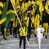 2016 Rio Olympics - Opening ceremony - Maracana - Rio de Janeiro, Brazil - 05/08/2016. Flagbærer Shelly-Ann Fraser-Pryce fører det jamaricanske OL-hold ind på Maracanã.