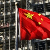 A Chinese national flag flutters at a construction site for a new residence complex in Beijing in this November 4, 2013 file photo.