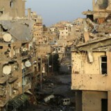 ARKIVFOTO: Smadrede bygninger i Deir al-Zor i Østsytien. Den voldsomme konflikt har haft omfattende og vidtrækkende konsekvenser for landets indbyggere, og går nu ind i sit syvende år.