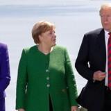 Trump sammen med Storbritanniens premierminister, Theresa May, og Tysklands kansler, Angela Merkel, ved begyndelsen af G7-mødet i Canada.
