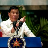 Philippine President Rodrigo Duterte gestures as he answers questions from the press at Manila International Airport on March 23, 2017. Duterte warned he may impose martial law and suspend elections for tens of thousands of local posts, fuelling concerns about democracy under his rule. Duterte said he was considering both measures as part of his controversial campaign to eradicate illegal drugs in society, and that martial law would also solve a range of other security threats. / AFP PHOTO / NOEL CELIS