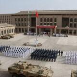 Den 1. august 2017 indviede Kina sin første udenlandske flådebase i Djibouti på Det Afrikanske Horn med deltagelse af en paradeenhed fra Folkets Hær. / AFP PHOTO / -