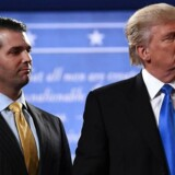 (FILES) This file photo taken on September 26, 2016, shows Republican presidential nominee Donald Trump (R) standing with his son Donald Trump Jr.  / AFP PHOTO / Jewel SAMAD