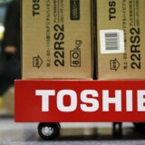 Boxes of Toshiba Corp's Regza liquid-crystal display (LCD) televisions are seen at an electronic store in Tokyo in this January 31, 2013 file photo. Toshiba Corp on April 6, 2015 dropped as much as 10.7 pct to 466.3 yen, the lowest since Feb. 3, after the company said it would appoint a committee to investigate possible problems with its accounting in its parent earnings for the year ended March 2014. REUTERS/Shohei Miyano/Files