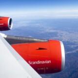 Et SAS-fly A340 over Rusland på sin flyvning fra København til Tokyo. SAS har måttet skuffe mange flypassagerer i Europa i højsæsonen med masseaflysninger af afgange.