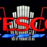 Tesco stiger efter rapport om bedring i supermarkedssektoren.