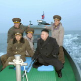 epa03614850 Handout image provided by Yonhap of North Korean leader Kim Jong-un (R) rides in a boat during a visit to a military unit on a western island bordering South Korea on March 7, 2013. The Rodong Sinmun, the daily of the North's Workers' Party, reported on March 8 that Kim visited two military units on the Jangjae and Mu islets, which conducted indiscriminate bombardment on South Korea's Yeonpyeong Island in October 2010, killing two marines and two civilians. Kim's inspection to check combat readiness followed a statement announced by the North Korean Army's supreme command on March 5. In the statement against the U.N. Security Council's discussions about tougher sanctions for the North's third nuclear test conducted on Feb. 12, Pyongyang declared that it will completely nullify the inter-Korean Armistice Agreement. The 15-member Council unanimously approved sanctions against the North on March 7. The two Koreas remain technically at war as the 1950-53 Korean ended in a truce. This is a capture from the March 8 edition of the Rodong Sinmun. EPA/YONHAP EDITORIAL USE ONLY/NO SALES