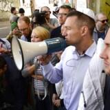 Den konservative Rasmus Jarlov, her under en støttedemonstration for jøderne, er blandt de politikere, der kræver skærpet sikkerhed for jøderne. Foto. Søren Bidstrup