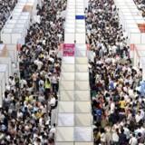 Thousands of job seekers visit booths at a job fair in Chongqing municipality, October 11, 2014.