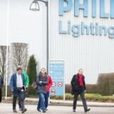 Unions representatives leave the Philips site after an extraordinary works council at technology firm Philips Lighting in Turnhout on December 11, 2014. AFP PHOTO / BELGA PHOTO / LUC CLAESSEN ** Belgium Out **