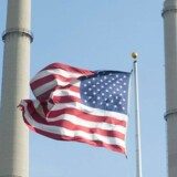 JOLIET, IL - MAY 07: An American flag hangs in front of NRG Energy's Joliet Station power plant on May 7, 2015 in Joliet, Illinois. According to scientists, global carbon dioxide (CO2) concentrations have reached a new monthly record of 400 parts per million, levels that haven't been seen for about two million years. The Environmental Protection Agency (EPA) reports the combustion of fossil fuels to generate electricity is the largest single source of CO2 emissions in the United States, followed by the burning of fossil fuels for transportation. Scott Olson/Getty Images/AFP == FOR NEWSPAPERS, INTERNET, TELCOS & TELEVISION USE ONLY ==