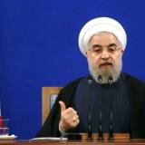 Irans præsident Hassan Rouhani gestikulerer under en pressekonference i den iranske hovedstad, Teheran, 29. august 2015. AFP PHOTO / ATTA KENARE