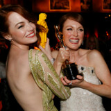 "Actress Emma Stone (L) compares her Lego Oscar statuette with actress Julianne Moore's genuine Oscar for best leading actress for her role in ""Still Alice"" at the Governors Ball following the 87th Academy Awards in Hollywood, California February 22, 2015 REUTERS/Mario Anzuoni (UNITED STATES - Tags: ENTERTAINMENT) (OSCARS-PARTIES)"