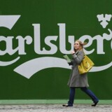 A woman walks past the Tetley's brewery in Leeds, northern England November 5, 2008. Danish brewer Carlsberg will focus its British operations on just one brewery at Northampton after its decision to close its Leeds Tetley's brewery on Wednesday due to falling beer sales in Britain. REUTERS/Nigel Roddis (BRITAIN)