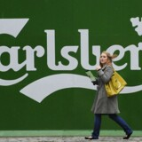File picture shows a woman walking past the Tetley's brewery in Leeds, northern England November 5, 2008.