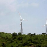 Power-generating windmill turbines are pictured in Suzlon wind farm at Sanodar village, 160 km (99 miles) west of the western Indian city of Ahmedabad, September 8, 2009. India hopes to set up by December next year energy efficiency targets for more than 700 industrial units, which account for 40 percent of India's fossil fuel use, the country's head of energy efficiency said on Monday. The wind farm, with 19 windmill turbines each generating 1250 kilowatt of electricity, is capable of producing 23.75 megawatt of green energy per hour, an official at the wind farm said. REUTERS/Amit Dave (INDIA ENERGY BUSINESS ENVIRONMENT)