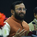 Prakash Javadekar (C), Indian Union Minister for Environment and Forests, speaks to media at a press conference in New Delhi on December 5, 2014. Javadekar held the press conference before his departure to the UN climate conference in Lima, Peru. AFP PHOTO / CHANDAN KHANNA