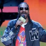 Et af de store navne på Tivolis »Fredagsrock 2015« er amerikanske Snoop Dogg. Arkivfoto: Ronald Martinez/AFP