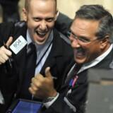 Et par glade børsmæglere på New York Stock Exchange. Onsdagen bød på stærke stigninger. Arkivfoto: TIMOTHY A. CLARY