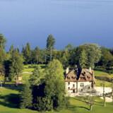 Évian Masters Golf Club er ikke bare smuk, men også en udfordrende fornøjelse, fordi banen ligger på en skråning. Bemærk udsigten ud over Genève-søen.