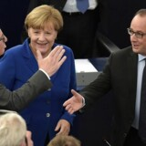 "European Commission's President Jean-Claude Juncker (L) shakes hands with French President Francois Hollande (R) next to German Chancellor Angela Merkel (C) prior to a joint address by Merkel and Hollande at the European Parliament on October 7, 2015 in Strasbourg, eastern France. Angela Merkel and Francois Hollande are set to give a joint address, the first such event by leaders of the two countries since 1989. Merkel and Hollande, the leaders of the European Union's two biggest economies, have played a driving role in a series of challenges that have gripped the 28-nation bloc, ranging from the migrant crisis to the Greek debt saga and the conflict in Ukraine. Failure to act in Syria risks stoking a ""total war"" in the Middle East, Francois Hollande said in a landmark speech to the European Parliament alongside Angela Merkel who said EU's asylum rules were ""obsolete"" as they put the burden on EU states where migrants first arrive to process claims for refugee status. AFP PHOTO / PATRICK HERTZOG"