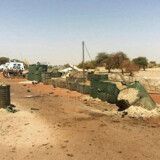 """A picture taken on April 16, 2018 shows the damages at the entrance of the International troops' """"Super Camp"""" neighbouring Timbuktu's airport following April 14, 2016 four-hour rocket, mortar and car bomb attack. Around 15 militants have been killed in an attack on a United Nations base in northern Mali's historic city of Timbuktu, the French military told AFP on April 15, 2018. / AFP PHOTO / STRINGER"""